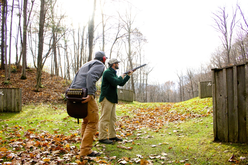 "Pete Kutzer and Scott McEnaney from  Orvis  tackle the ""Quail Walk"" at the shooting school."