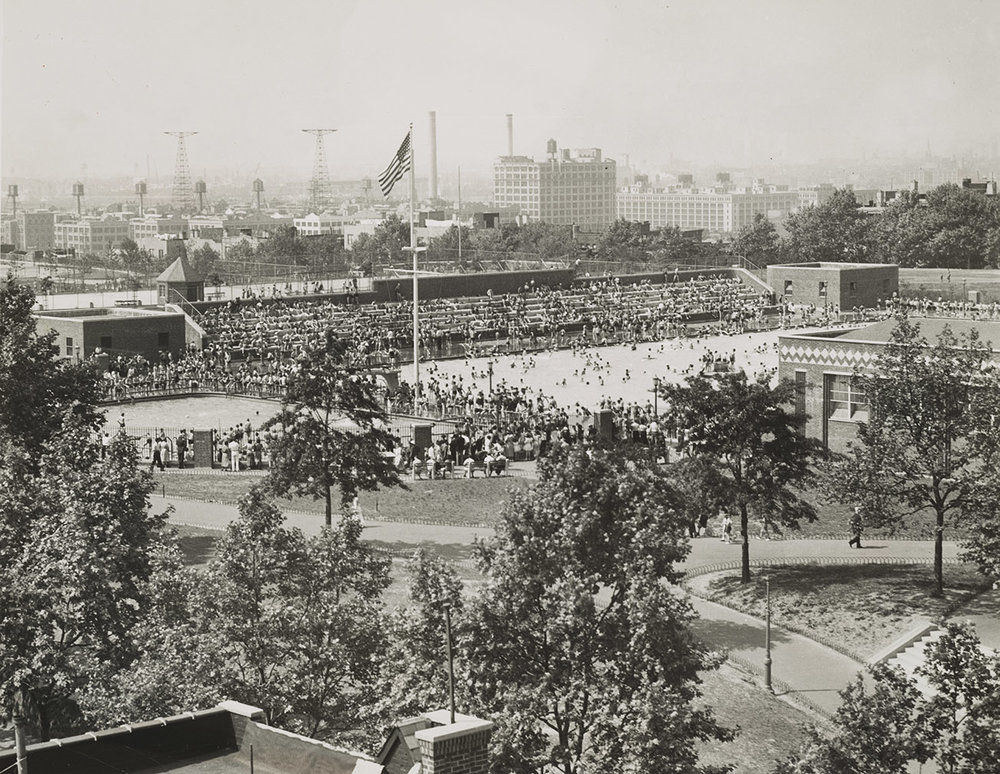 Undated photo of Sunset Park showing the main swimming pool and one of the smaller semi-circular pools. When the pool opened, it had a separate diving pool on one end and a wading pool on the other.    NYC Municipal Archives.