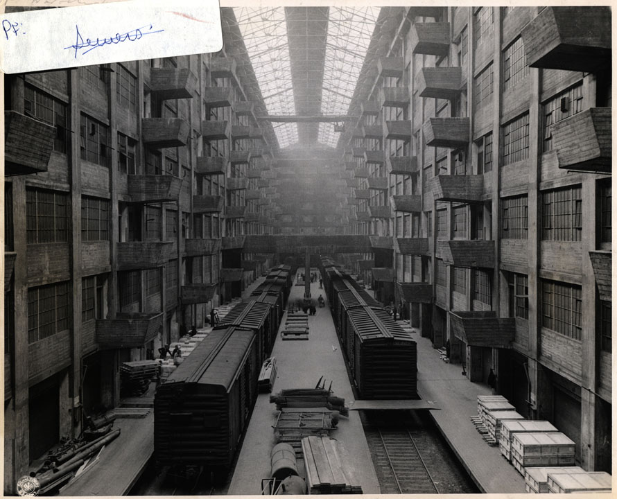 "Army Base Terminal, Port of Embarkation. The ""Well"": Ration cases from crate cars hoisted to warehouse bins for storage prior to shipment overseas. US Signal Corps, 1945-1946.  NYC Municipal Archives."