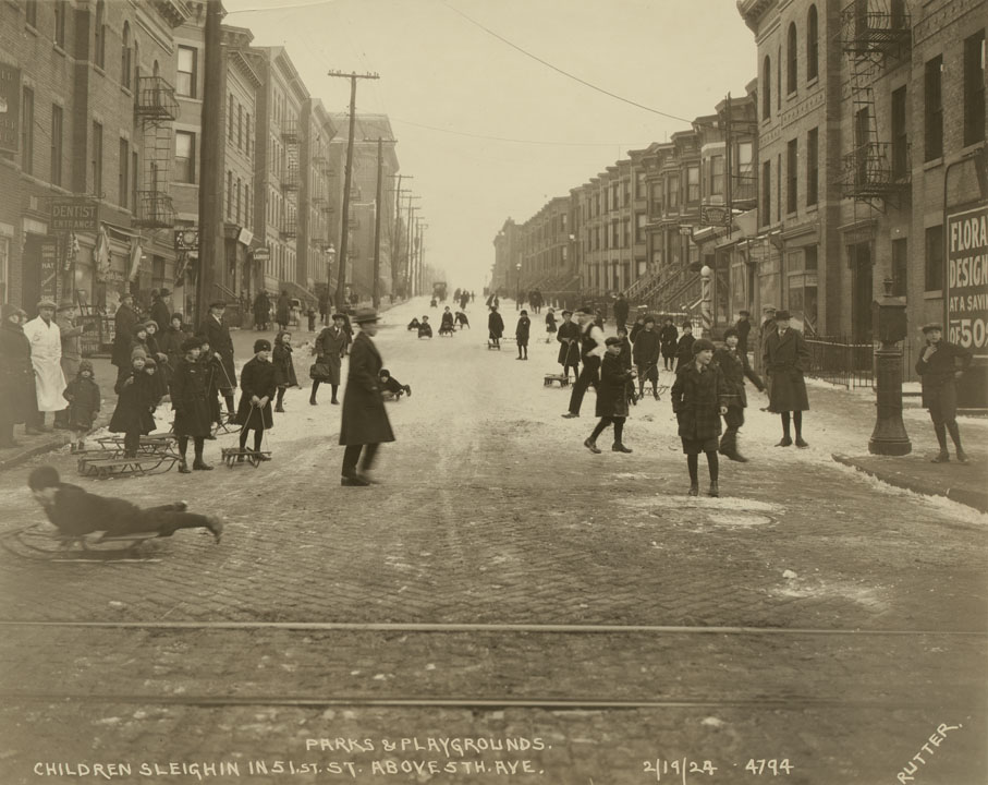 Children sleighing in 51st Street above 5th Avenue. Edward E. Rutter, February 19, 1924. NYC Municipal Archives.
