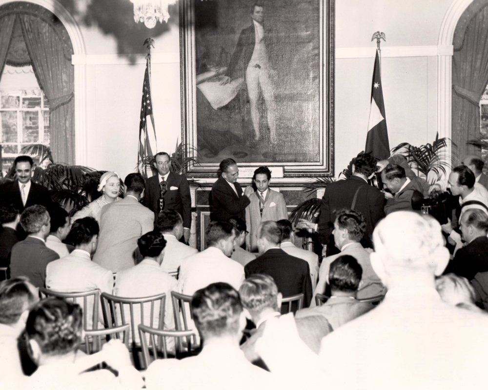 Medal of Honor Mayor Impellitteri awarding King Faisal II with the New York City Medal of Honor inside City Hall's reception chambers