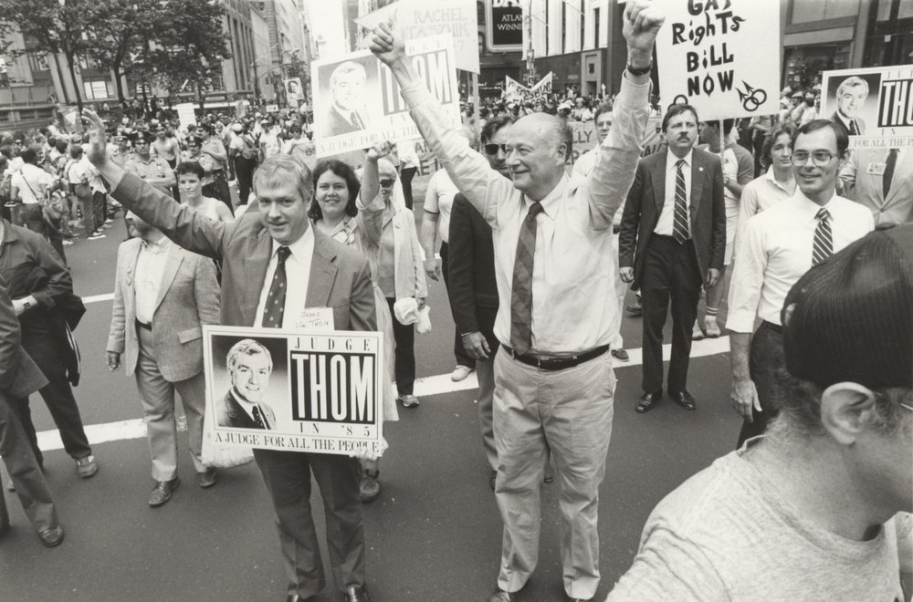 Mayor Koch marching in the 1985 Gay Pride march. Photograph by Holland Wemple. Mayor Edward I. Koch collection, NYC Municipal Archives.