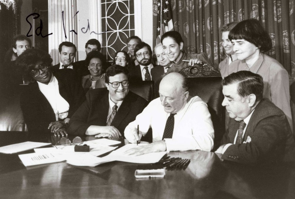 Signing of the Gay Rights Ordinance, 1986. Photograph by Joan Vitale Strong, Mayor Edward I. Koch Collection, NYC Municipal Archives.