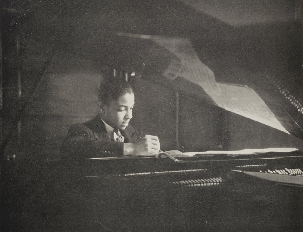 A young man composing a song in the music class at Haaren High School.