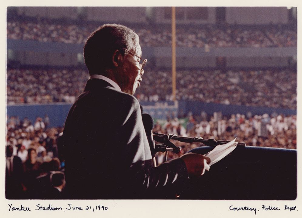 Nelson Mandela calls for an end to apartheid before a sold-out crowd at Yankee Stadium, June 21, 1990.  Mayor David N. Dinkins Photograph Collection, NYC Municipal Archives.