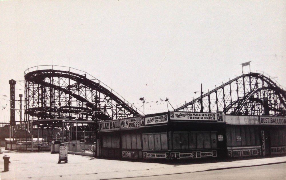 "Bowery between West 15th and 16th Streets, Brooklyn, 1964. The Thunderbolt roller coaster in Coney Island was built in 1925, two years earlier than the famous Cyclone. It made a cameo in Woody Allen's ""Annie Hall."" Department of Finance Collection, NYC Municipal Archives."
