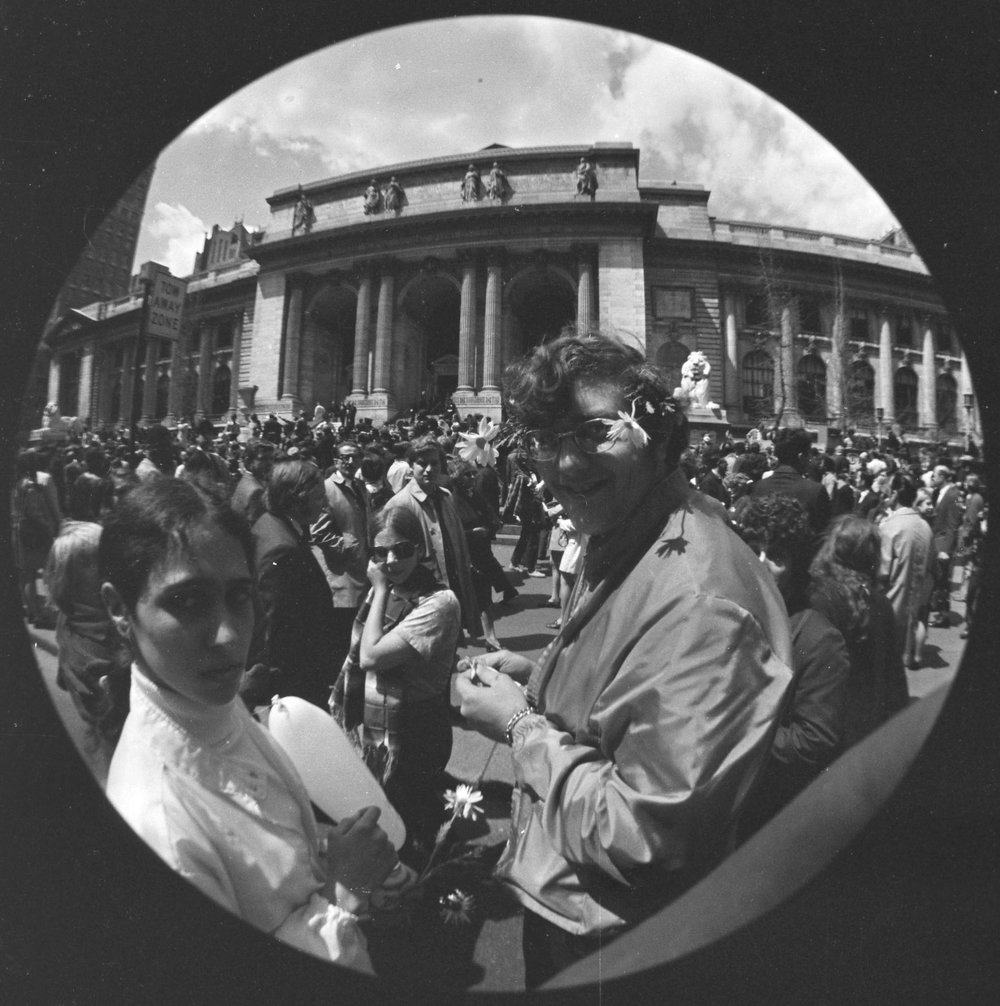 Fisheye photo showing New York Public Library during Earth Day, April 22, 1970  The first Earth Day included demonstrations demanding city and national protections for the environment. Mayor John V. Lindsay spoke from the steps of the New York Public Library and in Union Square about the need to reduce pollution and enact policies that would improve the quality of life.