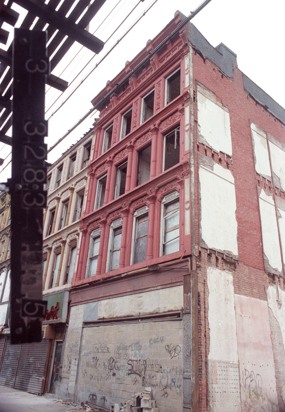 1235 Broadway in the 1980s shown, completely vacant with windows shattered. Department of Finance Collection, NYC Municipal Archives.