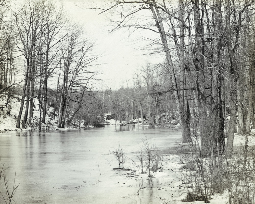 The Bronx River, with Lorillard Snuff Mill in the distance, Botanical Gardens, ca. 1890s. NYC Municipal Archives.