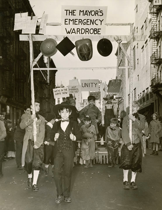 "Madison Square Boys' Club Thanksgiving Day Parade. ""The Mayor's Emergency Wardrobe Hanging fireman's helmet, mortarboard, shovel, music."" November 1940, Mayor Fiorello H. LaGuardia, NYC Municipal Archives."