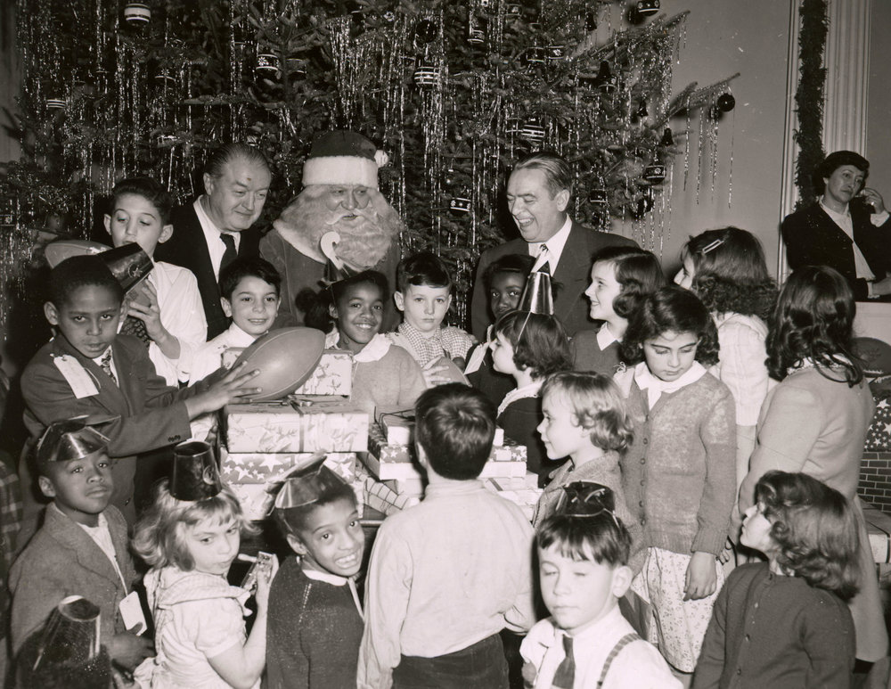 Santa Claus with Mayor O'Dwyer at the City Hall Christmas Party in 1948. Mayor O'Dwyer Collection, NYC Municipal Archives.