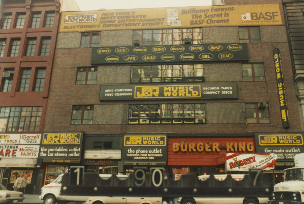 In the 1960s the Archives moved to 23 Park Row above a Burger King. In 1979 they moved to Tweed Courthouse and J&R Music World took over the space. Department of Finance 1980s Tax Photograph collection, NYC Municipal Archives.
