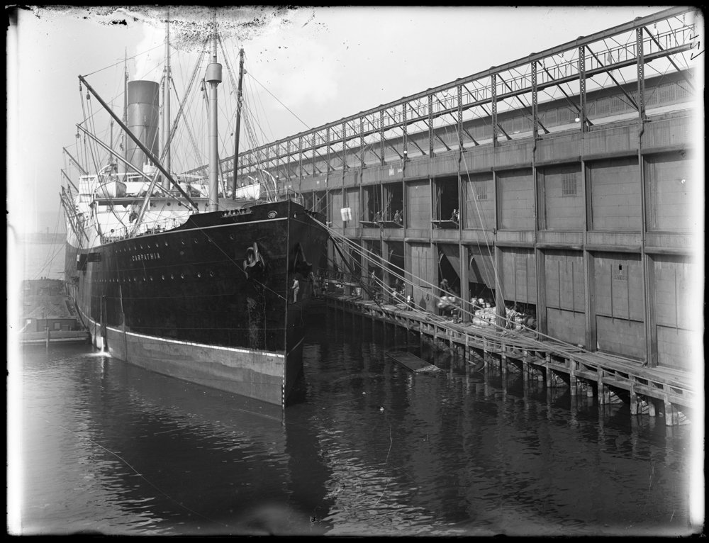 S.S. Carpathia docked at Chelsea Piers, 1912. While we cannot be sure, archivists suspect this photograph was probably taken after the Carpathia arrived with survivors of the Titanic disaster. Department of Docks & Ferries collection, #697,NYC Municipal Archives.
