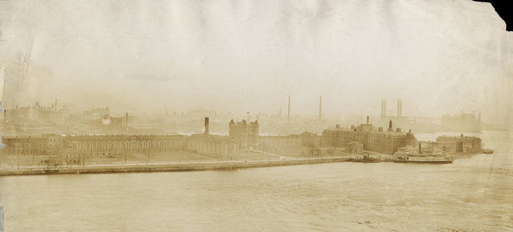 Blackwell's Island looking southeast: Penitentiary, Charity Hospital with Superintendent's cottage, Smallpox Hospital, Reception Pavilion, ca. 1900. Department of Public Charities Collection, NYC Municipal Archives.