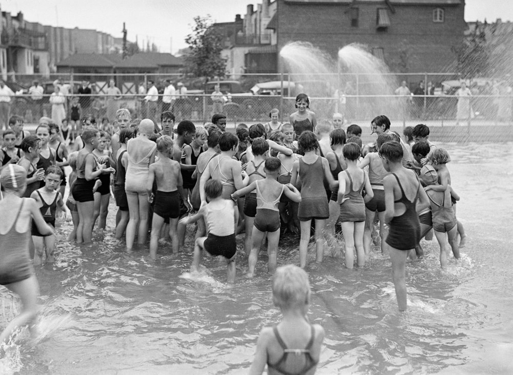 Denis P. Gorman Memorial Playground, Jackson Heights, Queens: Opening ceremonies, children grabbing for melon, August 11, 1934. Department of Parks & Recreation Collection, NYC Municipal Archives.