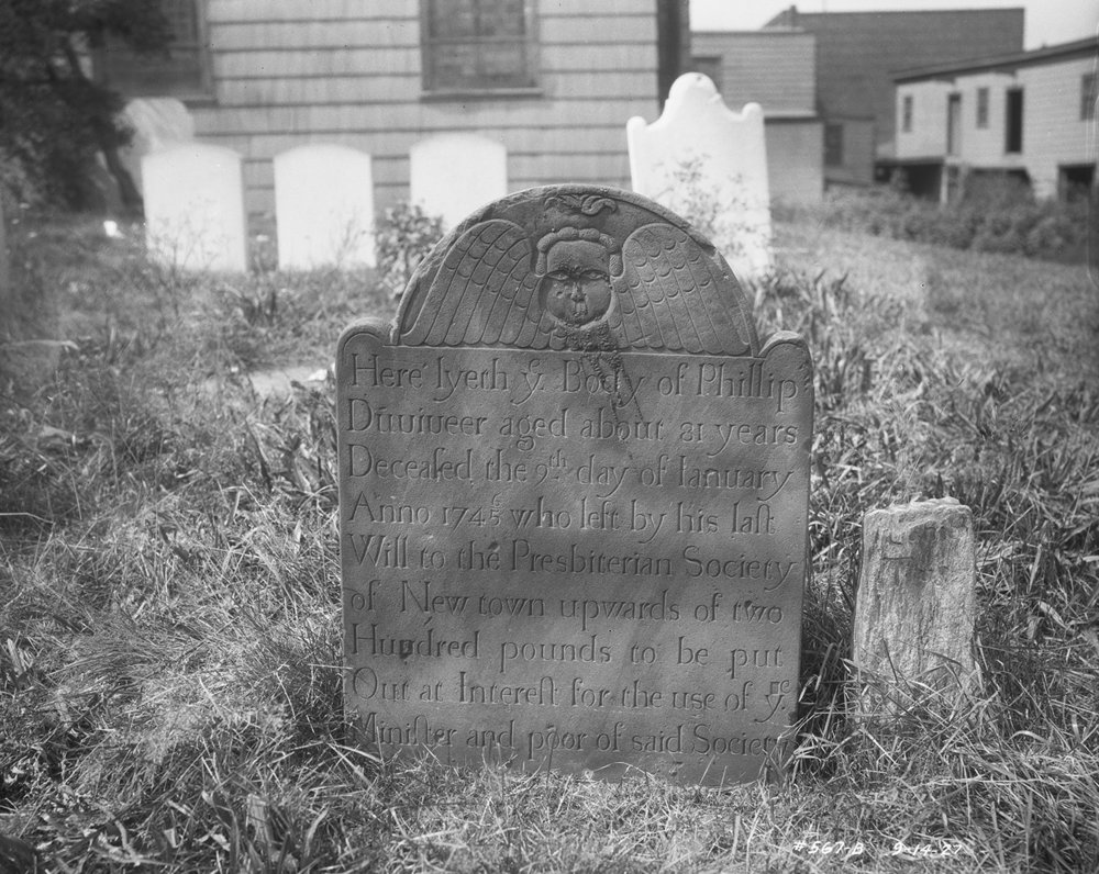 "Old Presbyterian Church Gravestone ""Phillip Duvineer ages about 81 years"" (Died 1745 leaving 200 pounds and interest to the Presbiterian (sic) Society, according to stone), September 14, 1927. Borough President Queens Collection, NYC Municipal Archives."