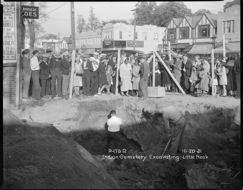 Excavating Indian Cemetery on Northern Boulevard, Little Neck, Queens, October 20, 1931. The three people standing inside the fence are most likely tribal representatives. Borough President Queens Collection, NYC Municipal Archives.