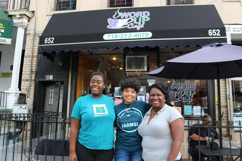 From left to right, Porscha Williams-Fuller, Zulmilena Then (founder of Preserving East New York), and Farrah Lafontant, pictured in front of café along Pennsylvania Avenue in ENY.