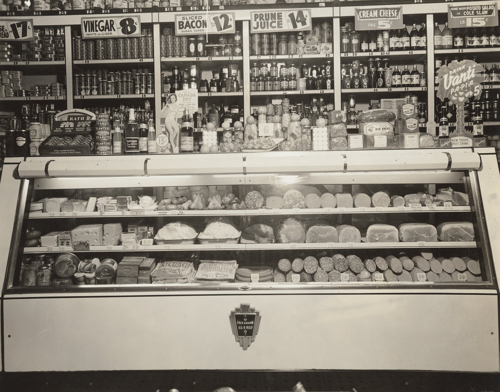 Refrigerated case display in delicatessen, ca. 1939.  WPA FWP Shop Interiors, #11.  Photograph by George W. King, National Delicatessen Grocer