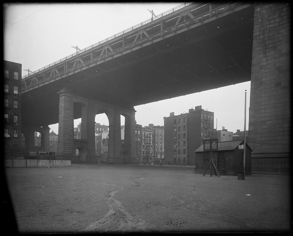 BPS_iii_1812: Manhattan Bridge view showing play grounds and park at Cherry Street looking northwest, May 29, 1917. Photo by Eugene de Salignac, Department of Bridges, Plant and Structures Collection, NYC Municipal Archives.