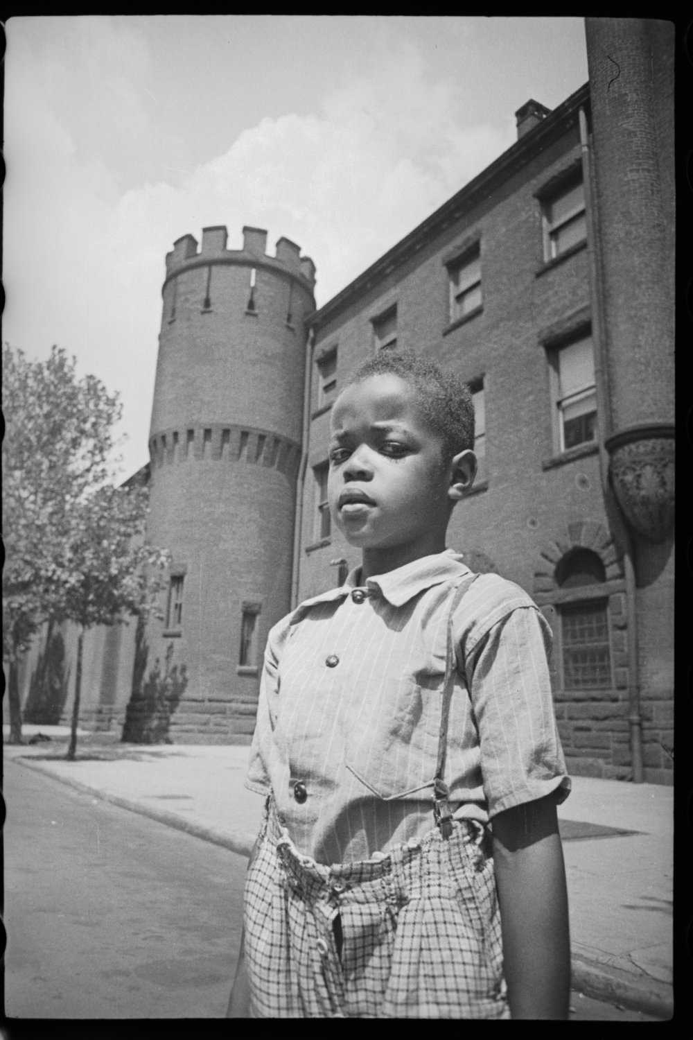 This photo in front of the 23rd Regiment Armory on Pacific Street and Bedford Avenue in Crown Heights, Brooklyn must have been taken by the young photographer above. The frame just prior is a selfie that shows a corner of the armory.