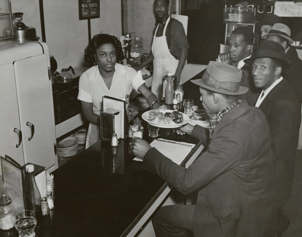 Counter of the Unique Lunch, 195 West 135th Street, December 14, 1937. Photograph by Aubrey Pollard, WPA Federal Writers' Project collection, NYC Municipal Archives.