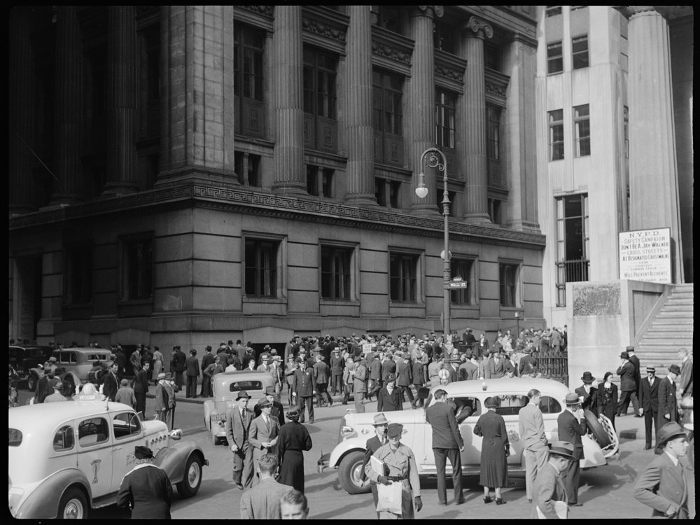 Taxis picking up fares on the corner of Wall and Nassau Streets, ca. 1937. Photographer unknown, WPA Federal Writers' Project collection, NYC Municipal Archives.