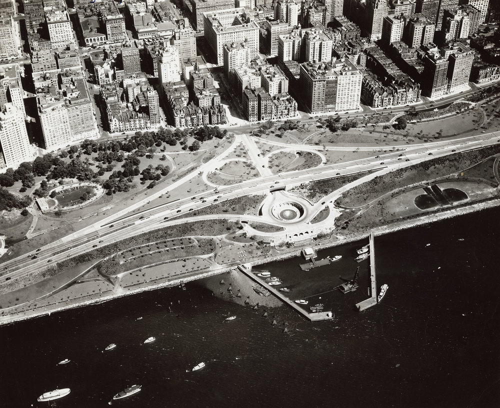 "Aerial view of the 79th Street Boat Basin and Henry Hudson Parkway interchange, ca. 1936. NYC Municipal Archives Collection. Moses leveraged federal highway funding to complete an earlier ""West Side Improvement"" plan and added a marina, known as the 79th Boat Basin in Riverside Park."