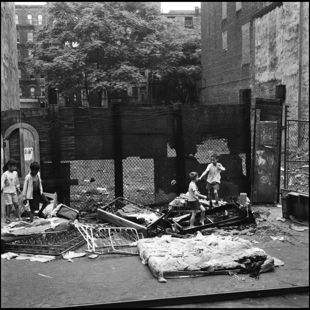 Children playing on East 10th Street, between Avenue B and C, July 1966. Photograph by Paul Rice.