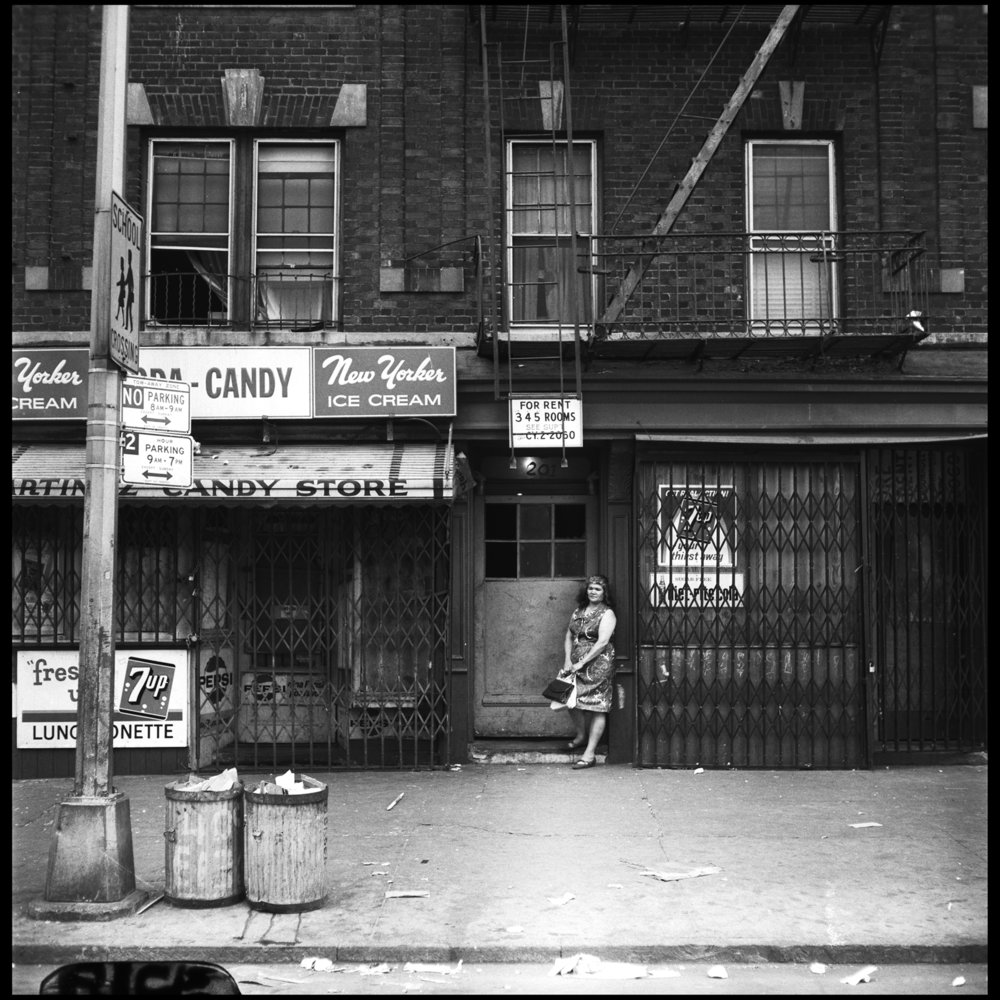 Woman in the doorway of 201 Brook Avenue, Bronx, June 1967. Photograph by Paul Rice.