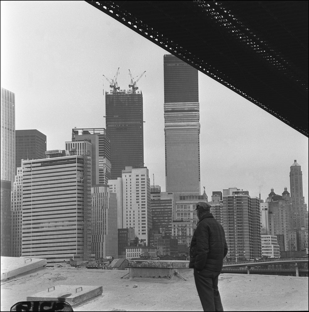 World Trade Center towers under construction, seen from underneath the Brooklyn Bridge, 1971. Photograph by Paul Rice.