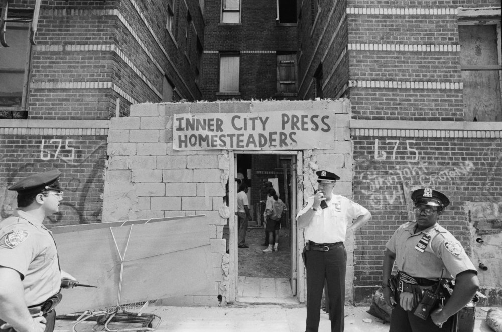 Squatter Eviction, 675 East 170th Street, South Bronx, July 1993. Photograph by Larry Racioppo.