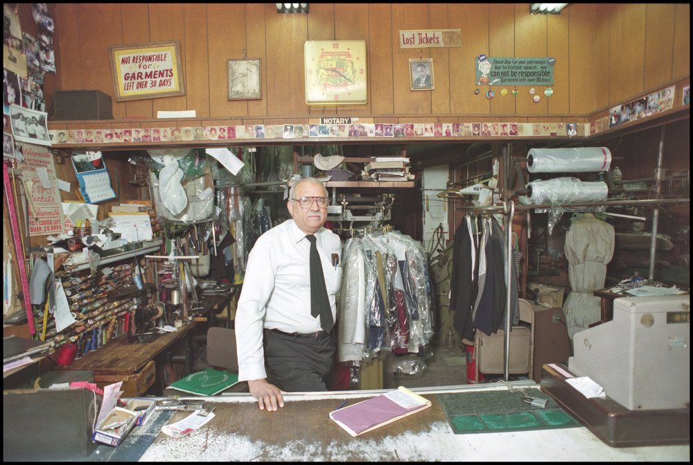 Dry cleaner, West 140th Street, Harlem, June 1994. Photograph by Larry Racioppo.
