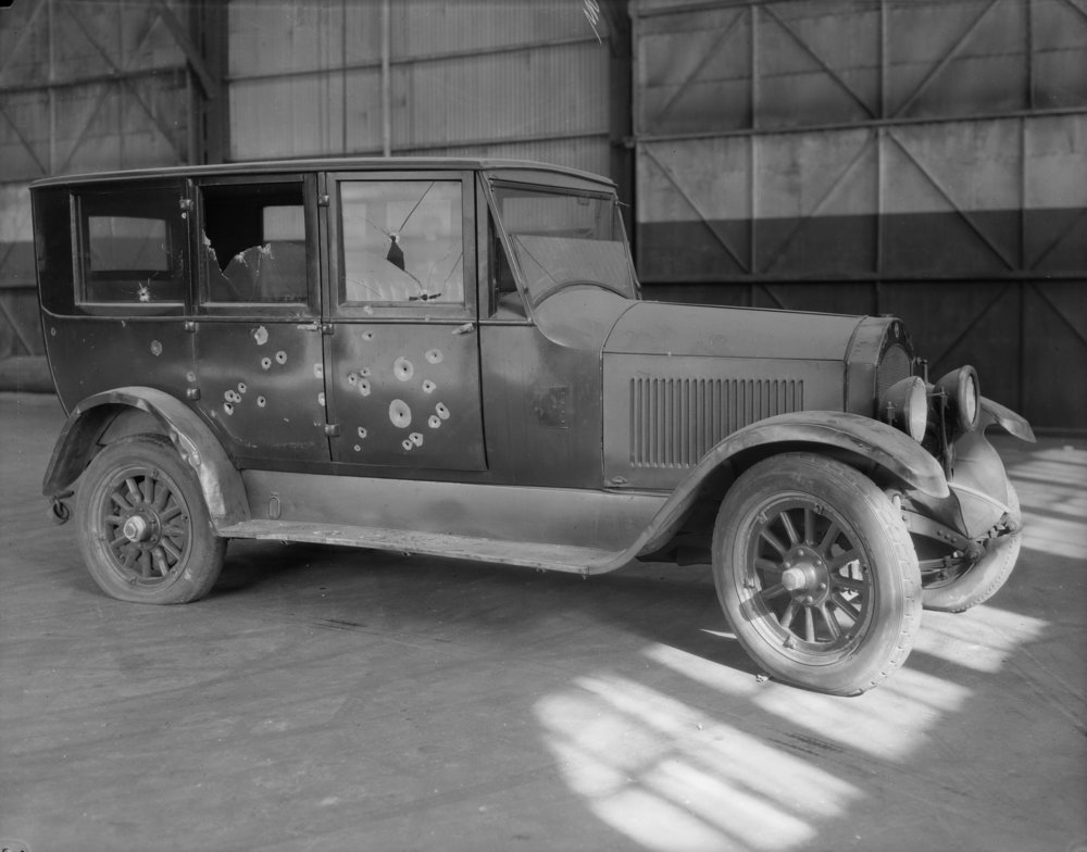 NYPD 8529a: Automobile, showing bullet holes taken on East 25th Street pier for Insp. Noonon, October 27, 1926. E. Tobin, NYPD Collection, NYC Municipal Archives.