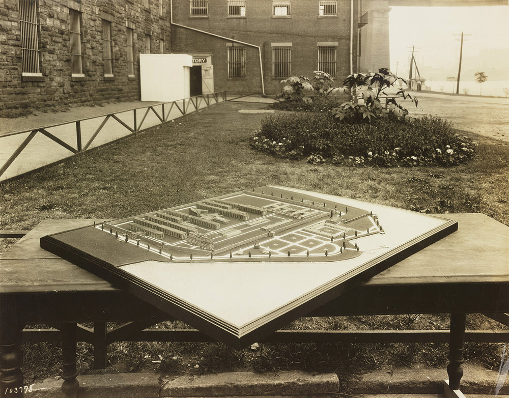 """MAC 1928: Model of new penitentiary on Rikers Island """"to be completed in 1933."""" Photo taken in front of the Blackwell's Island Prison, ca. 1932. Edwin Levick, NYC Municipal Archives Collection."""