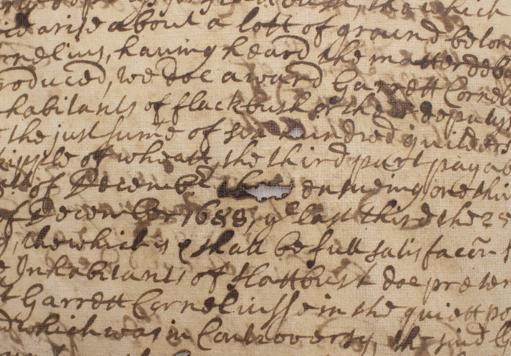 "Example of ""burn through"" in an untreated page with iron gall ink."