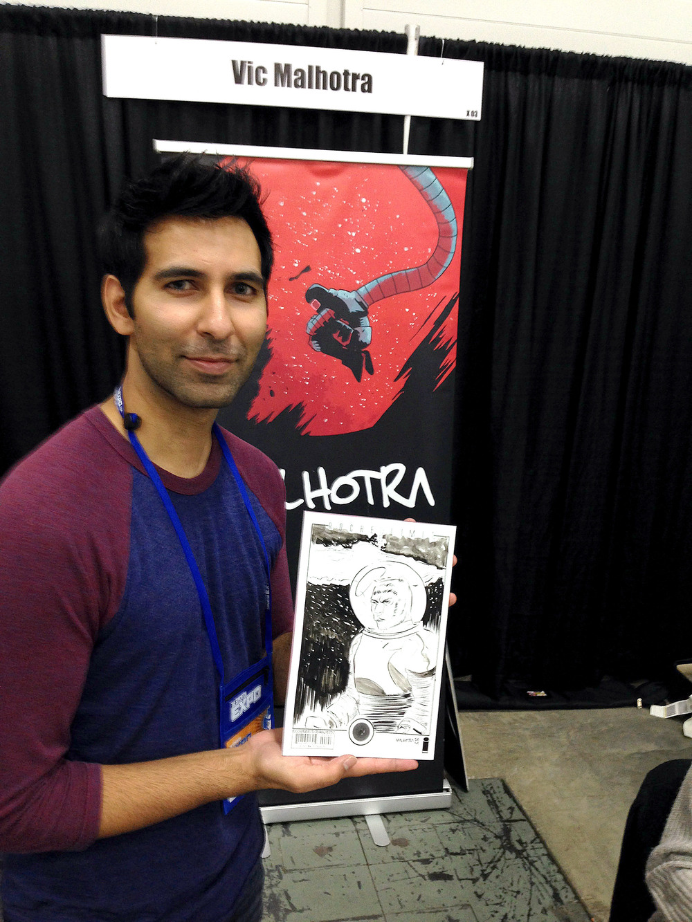Edmonton Expo 2014: Vic Malhotra holding the Tiger Lawyer sketch he did on the back of the Roche Limit #1 black and white phantom variant.