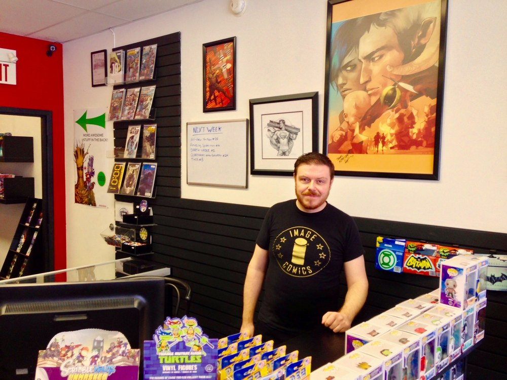 Chris, owner of Alpha Comics in Calgary, Alberta, Canada (Photo credit: GeekNerdNet.com)