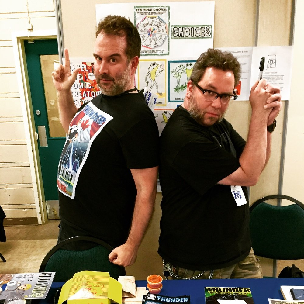 (L to R): Michael McAdam and Kyle Burles at the 2018 Panel One Comic Creator Festival  ( Photo credit: Chris Doucher/GeekNerdNet)