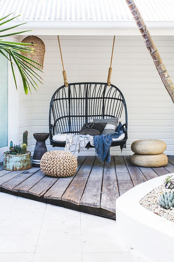 Outdoor Bohemian space with rattan swing found on Pinterest via My Plant Club.