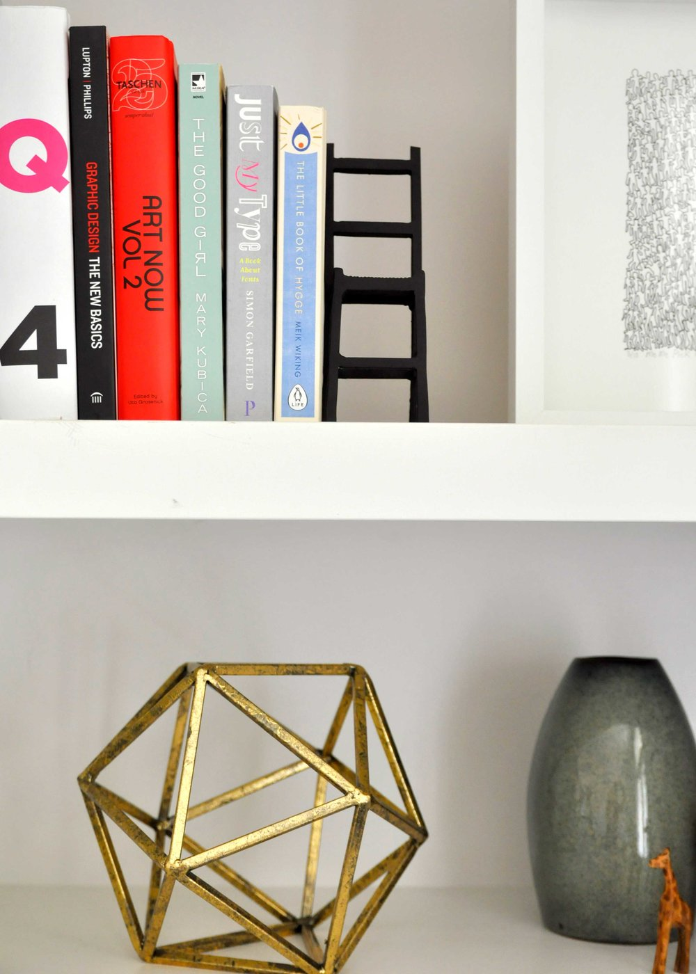 Style tip    - Add groupings of books. Mix it up with vertical and horizontal groupings.