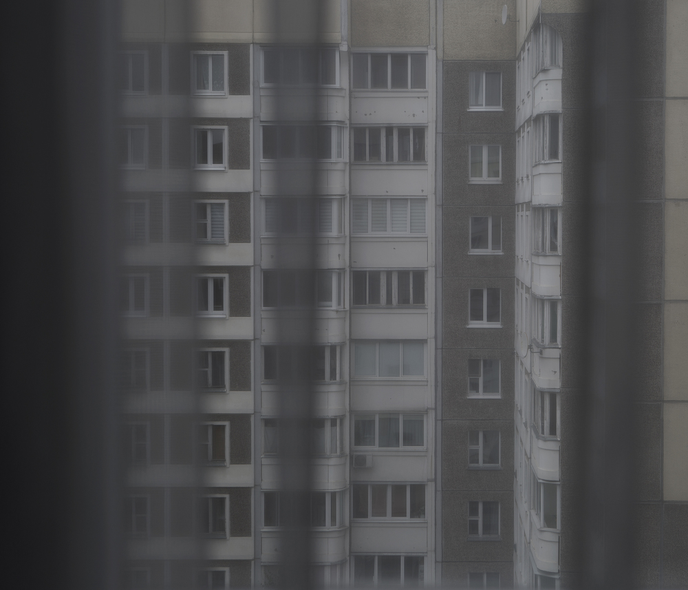 jadwiga bronte.old red.belarus.misk.soviet union.grey day.window.block of flats.jpg