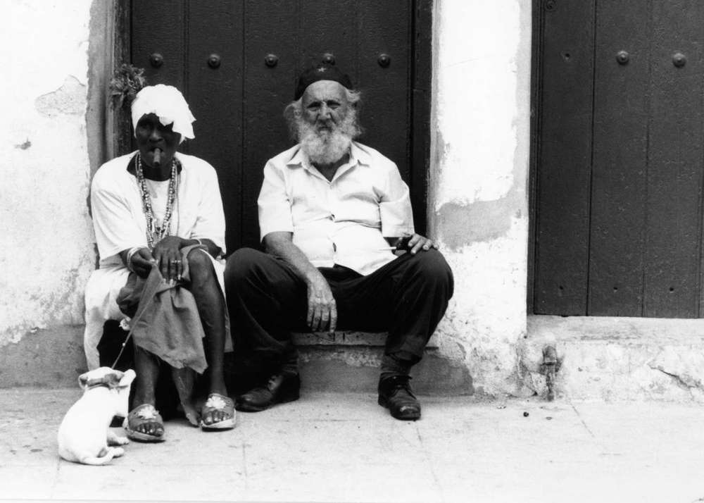 Cuba_woman-cigar-and-old-man-hat-Cuba168.jpg