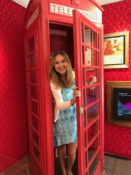 Abby posing in the 10th floor telephone booth!