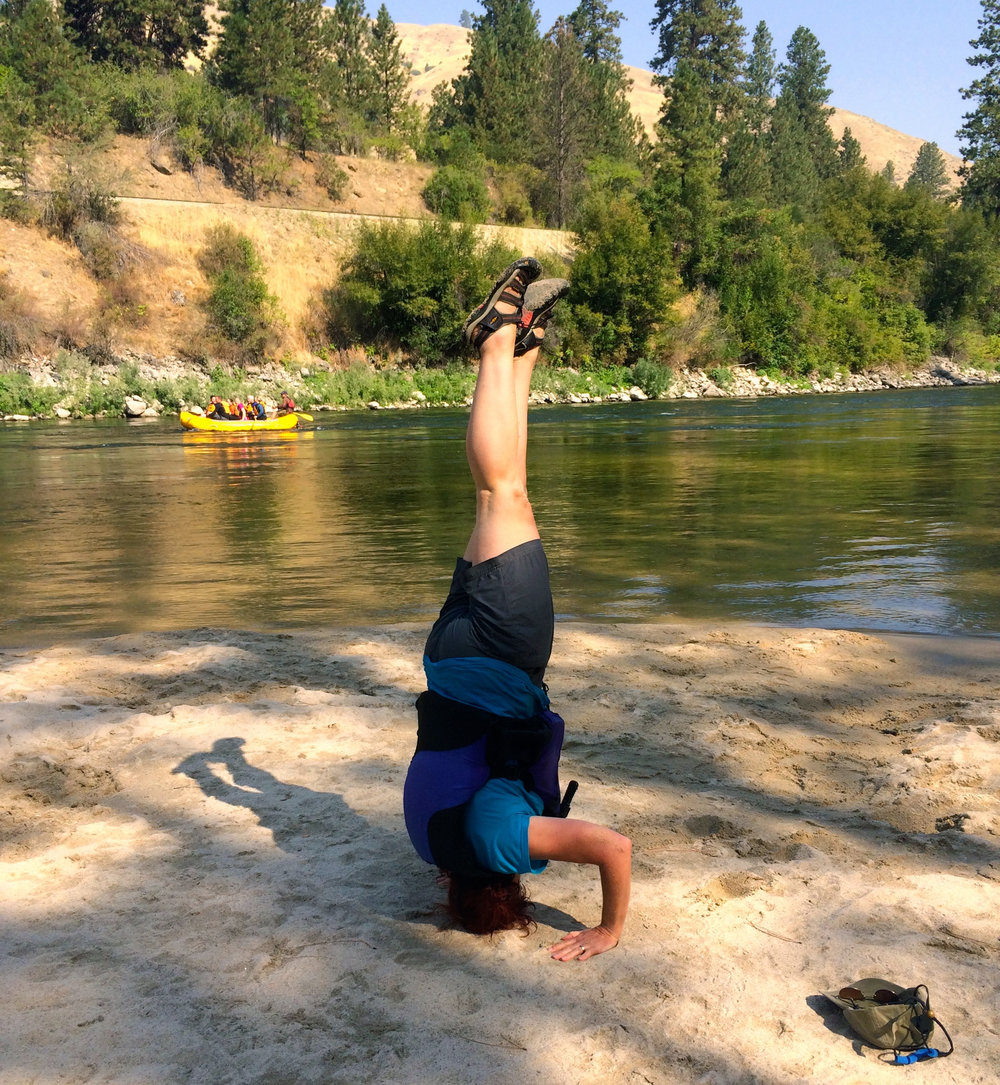 Thanks to yoga, I can accept my brother Doug's dare to stand on my head! It was a great day of rafting near Boise, Idaho.