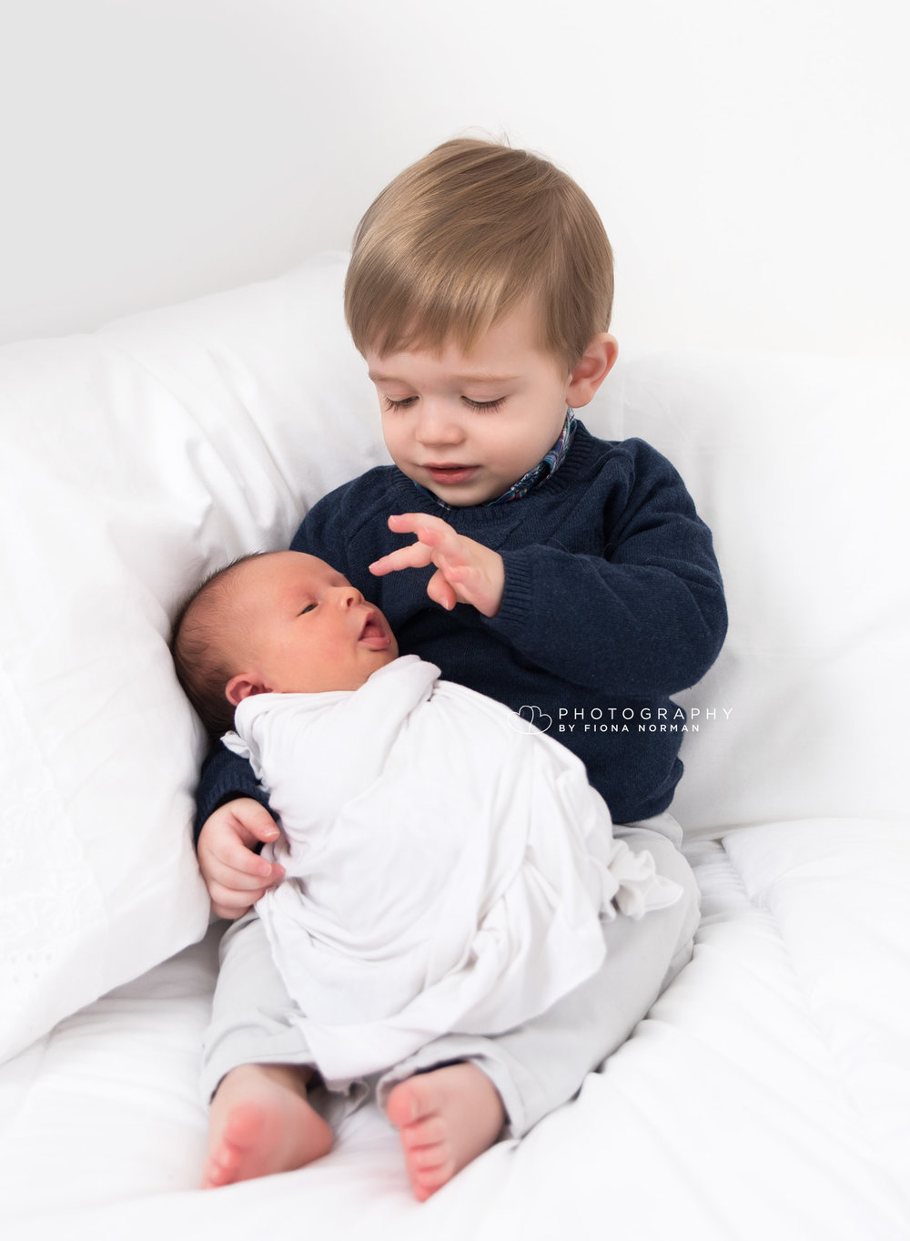 newborn baby and big brother.jpg