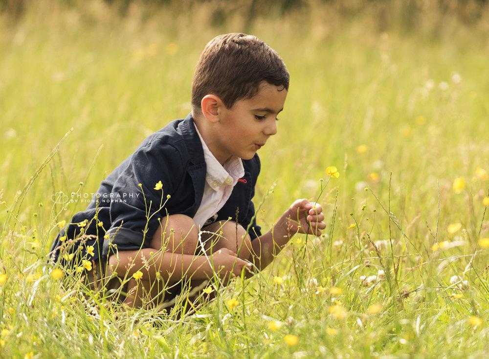 boy picking flower.jpg