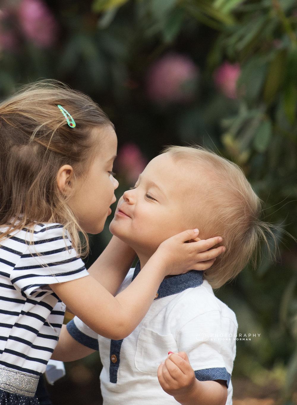 sister giving a kiss.jpg