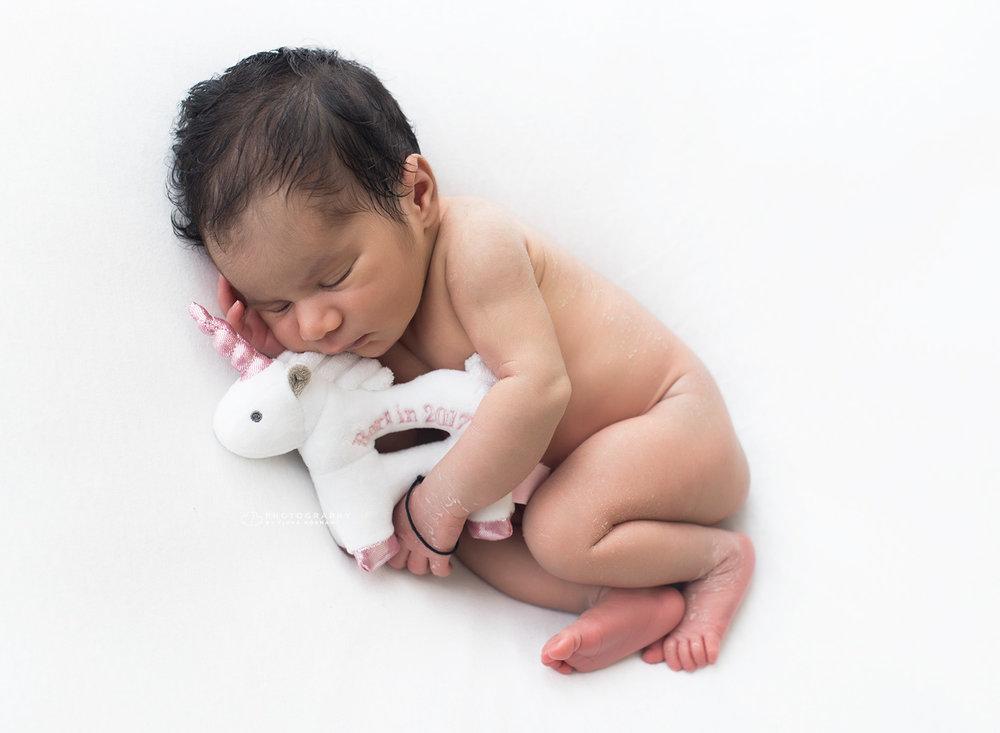 newborn baby girl with teddy.jpg