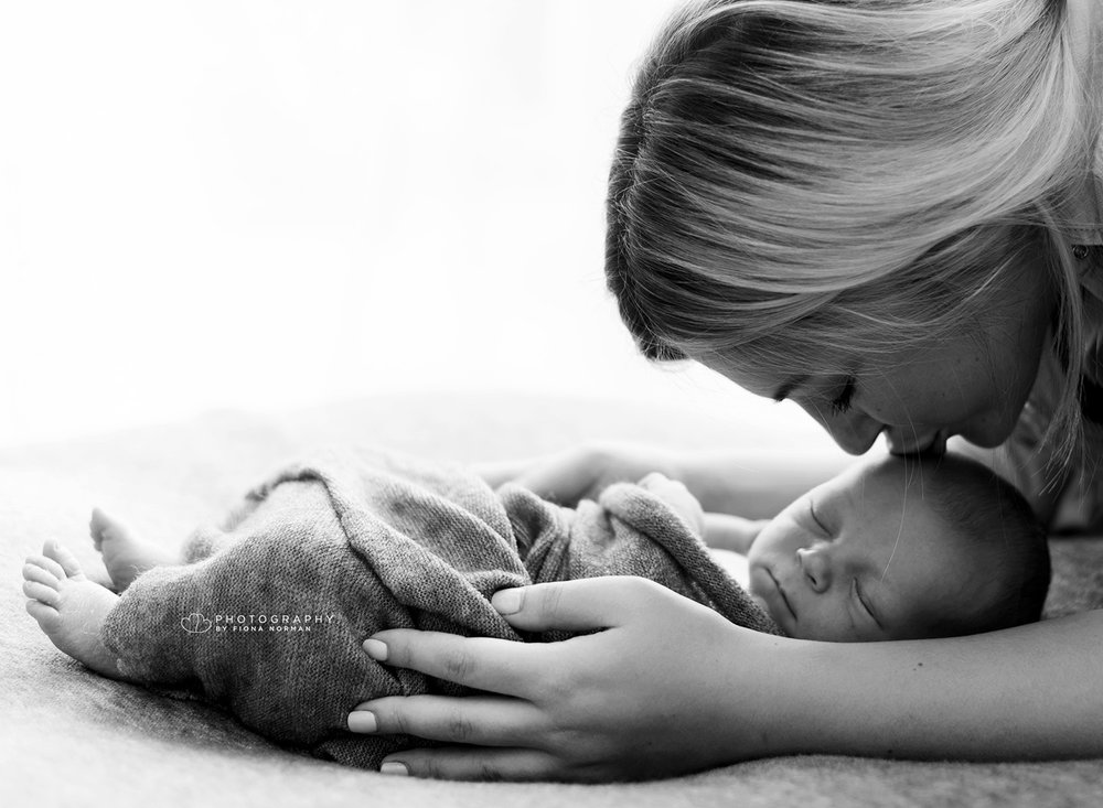 mum_kissing_baby.jpg